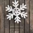 Vector white paper christmas snowflake on a wood background — Stock Vector