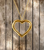 Golden heart at the chain for Valentines day design — Stockvector