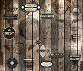 Vector set of calligraphic design elements, page decoration, Premium Quality and Satisfaction Guarantee Label collection, Vintage wood background — Vetor de Stock