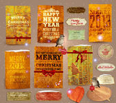 Set of vector Christmas ribbons, old dirty paper textures and vintage new year labels. Elements for Xmas design: birds with baubles, gingerbread, ribbon bows, candy cane, stars and glow snowflakes — Stok Vektör
