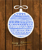 Christmas bauble, wooden vintage background — Stock Vector