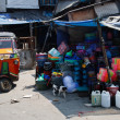 Tuktuk in a junk market — Stock Photo
