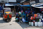Tuktuk in a junk market — Stock Photo