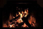 Logs burning in fireplace — Stock Photo