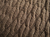 Knitted fabric - macro of a brown woolen texture — Stock Photo