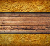 Vintage creased paper with wood — Stock Photo