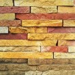 Colorful cut stone wall — Stock Photo