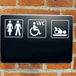 Toilette sign on wall - Stock Photo