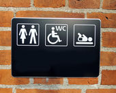 Toilette sign on wall — Stock Photo