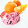 Tangerines and measure tape — Stock Photo