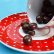 Chocolate candy in empty cup of coffee — Stock Photo #33432851