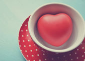 Red polka dot cup of coffee with heart inside vintage — Stock Photo