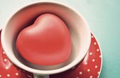 Red polka dot cup of coffee with heart vintage — Stok fotoğraf
