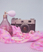 Old vintage camera with parfume — Stock Photo