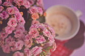 Vintage flowers an cup of coffee — Stock Photo