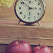 Vintage books with clock and apples — Stock Photo