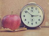 Vintage clock and book — Zdjęcie stockowe