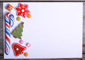 Blank paper with candy and Christmas decoration — Stockfoto
