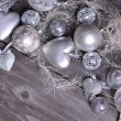 Christmas ornaments and gift ribbon on painted wood — Stockfoto #36631359