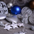 Christmas ornaments and gift ribbon on painted wood — Stok Fotoğraf #36653369
