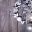 Christmas ornaments and gift ribbon on painted wood — Stockfoto #36653671