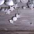 Christmas ornaments and gift ribbon on painted wood — Stok Fotoğraf #36653777