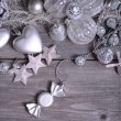 Stockfoto: Christmas ornaments and gift ribbon on painted wood