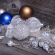 Christmas ornaments and gift ribbon on painted wood — Stockfoto #36655387