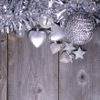 Christmas ornaments and gift ribbon on painted wood — Stok Fotoğraf #36656983