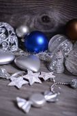 Christmas ornaments and gift ribbon on painted wood — Stock Photo