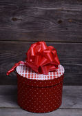 Christmas box for present on wooden background — Stock Photo