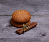 Cinnamon and gingerbread on wooden — Stock Photo