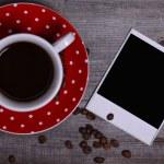 Coffee and polaroid photo paper — Stock Photo