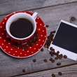 Coffee and photo paper on wooden — Stock Photo #36876299