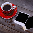 Cup of coffee and photo papers — Stock Photo