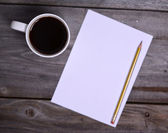 Coffee with white blank paper — Stock Photo