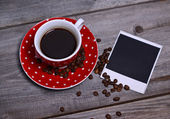 Coffee and photo paper on wooden — Stock Photo