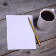 White mug of coffee and blank paper — Stock Photo