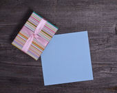 Small box with blank blue paper — Stok fotoğraf