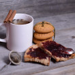Mug of tea and jam for breakfast — Stock Photo