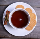Cookies and cup of tea on wooden background — Stock Photo