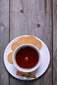 Cookies with cinnamon and cup of tea — Stock Photo