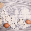 Ingredients and molds for baking cookies on wooden — Stock Photo