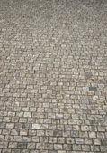 Graniet cobblestoned stoep achtergrond — Stockfoto