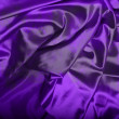 图库照片: Dark purple silk background