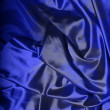 Foto Stock: Dark blue silk background