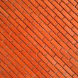 Red diagonal brick wall — Stock Photo #43527277