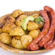 Baked potato with sausage — Stock Photo