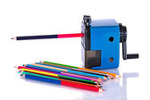 Colored pencils with sharpener — Stock Photo