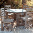 Old wooden chairs and a table — Stock Photo